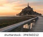 mont saint michel at sunset in...