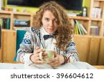 female student studying in... | Shutterstock . vector #396604612