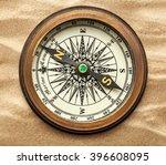 vintage brass compass on sand... | Shutterstock . vector #396608095