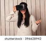 woman in virtual reality helmet.... | Shutterstock . vector #396628942