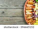 stuffed squid on an old wooden... | Shutterstock . vector #396665152