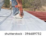 man working on roof metal... | Shutterstock . vector #396689752