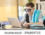 Businessman working on line or searching travel destinations with goggles needing vacations at office