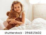 Sweet Little Girl Is Hugging A...