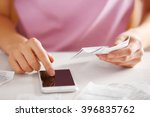 woman with bills and smart... | Shutterstock . vector #396835762