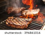 Steaks Cooking Over Flaming...