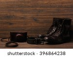 leather boots on wooden surface | Shutterstock . vector #396864238