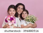 Girls Giving Flowers On Mother...