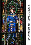 Small photo of COLOGNE, GERMANY - APRIL 21, 2010: Stained Glass window depicting a medieval king in the Dom of Cologne, Germany.