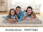 family on floor lying in living ... | Shutterstock . vector #39697684