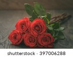 five red roses on wooden table  ... | Shutterstock . vector #397006288
