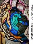 Small photo of SLUPSK, POLAND - 27 MARCH 2016 - stained glass window depicting the creation of Adam and Eve