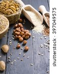 nuts and cereal seeds on black... | Shutterstock . vector #397049575