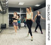 Small photo of Group Of Women Exercising In Dance Studio