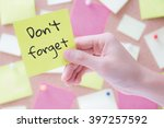 hand holding a notepaper or... | Shutterstock . vector #397257592
