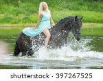 Young Woman Riding Horse At A...