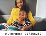 black mom and daughter reading... | Shutterstock . vector #397306252