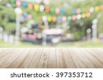 empty wooden table with blurred ... | Shutterstock . vector #397353712