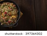 delicious asian rice on a black ... | Shutterstock . vector #397364302