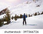Skier Skiing On Easy Blue Trai...