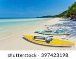 Kayaks At The Tropical Beach A...