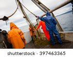 Fishermen In Protective Suits...