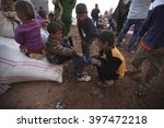 syrian refugees who escaped... | Shutterstock . vector #397472218