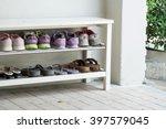 outdoor shoe rack and 8 pairs...   Shutterstock . vector #397579045