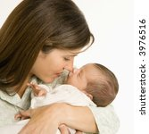 mother nuzzling sleeping baby... | Shutterstock . vector #3976516