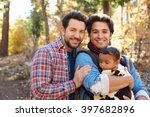 Gay Male Couple With Baby...