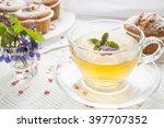cup of green tea with lemon... | Shutterstock . vector #397707352