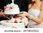 bride and groom are cutting... | Shutterstock . vector #397803502