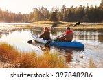 Stock photo couple kayaking on lake back view big bear california 397848286