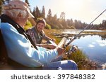 father and adult son fishing... | Shutterstock . vector #397848382