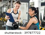 female personal trainer helping ... | Shutterstock . vector #397877722