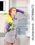 young woman cleaning empty... | Shutterstock . vector #397888672