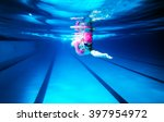 woman swimming freestyle  under ... | Shutterstock . vector #397954972