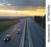 car traffic against the sunset... | Shutterstock . vector #397963486