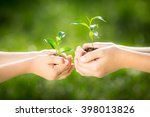 children holding young plant in ... | Shutterstock . vector #398013826