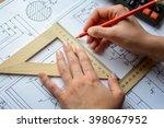 girl architect draws a plan
