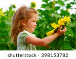 girl in the sunflowers field  | Shutterstock . vector #398153782
