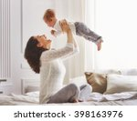 Stock photo happy loving family mother playing with her baby in the bedroom 398163976