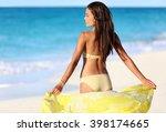 beach woman relaxing in yellow... | Shutterstock . vector #398174665