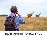Photographer Taking Photo Of...