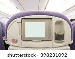White Lcd Screen In An Airplan...