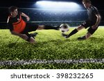two soccer players kicking a... | Shutterstock . vector #398232265