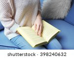 woman  reading book at home ...   Shutterstock . vector #398240632