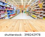 Stock photo wood floor and supermarket blur background product display template 398242978