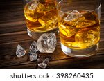 two glasses with ice and... | Shutterstock . vector #398260435