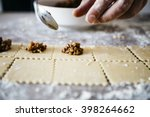 making ravioli on a wooden... | Shutterstock . vector #398264662